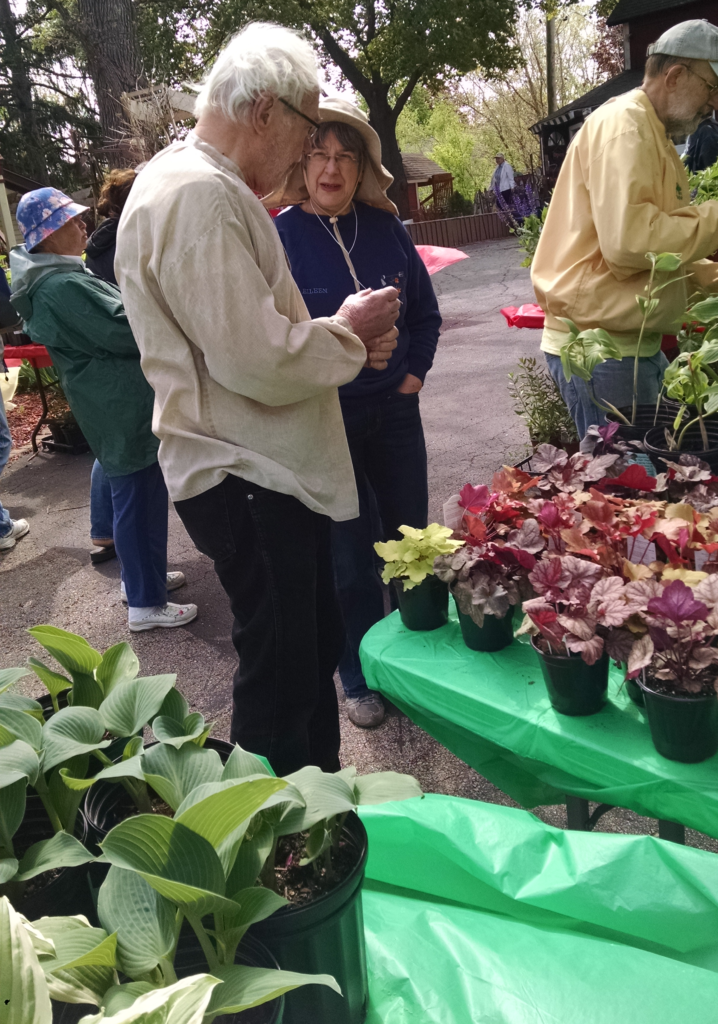 Eileen with customer at plant sale 2016